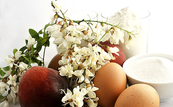 Few ingredients recipe: eggs, milk, flour, sugar, flowers and peaches