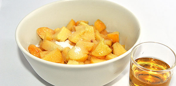 Peaches release their juice in sugar and brandy